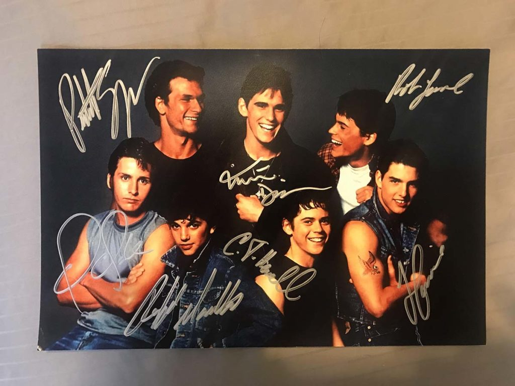 Cast of The Outsiders photo autographed by Patrick Swayze, Tom Cruise, Rob Lowe, Matt Dillon, Ralph Macchio, Emilio Estevez