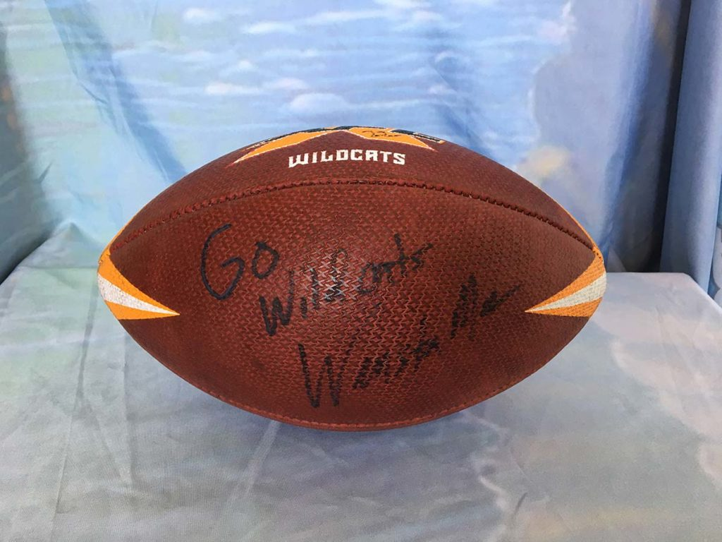LA Wildcast signed football by Coach Winston Moss